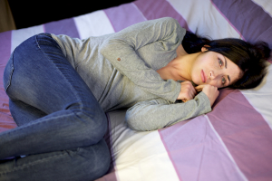 Sad lonely beautiful woman in bed with family problem